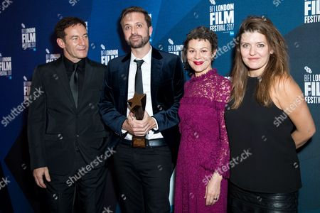 Stock Image of Director John Trengove (2L) with Jason Isaacs, Helen McCrory and Melissa Parmenter after receiving the Best Feature Film award for his film 'The Wound'