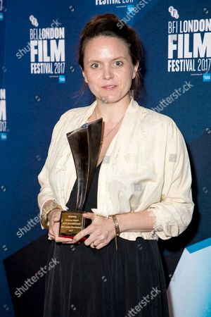Documentary competition winner Lucy Cohen with the Grieson award for her film 'Kingdom of Us'