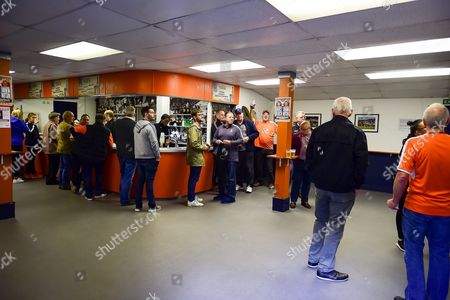 """Fans enjoy a pint  in the """"Nick Owen Bar"""" during the EFL Sky Bet League 2 match between Luton Town and Stevenage at Kenilworth Road, Luton"""