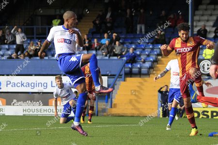 Bury striker Jermaine Beckford (9) scores a goal to make the score 2-1 during the EFL Sky Bet League 1 match between Bury and Bradford City at the Energy Check Stadium at Gigg Lane, Bury