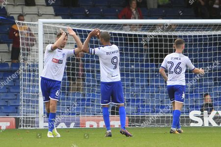 Bury defender Eoghan O'Connell (6) and Bury striker Jermaine Beckford (9) celebrate during the EFL Sky Bet League 1 match between Bury and Bradford City at the Energy Check Stadium at Gigg Lane, Bury