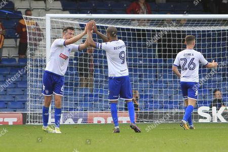 Bury striker Jermaine Beckford (9) and Bury defender Eoghan O'Connell (6) celebrate during the EFL Sky Bet League 1 match between Bury and Bradford City at the Energy Check Stadium at Gigg Lane, Bury