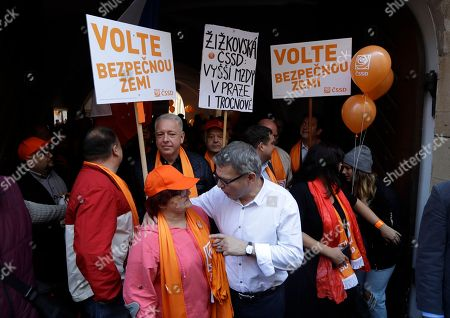 "Election leader of Social Democrats Lubomir Zaoralek, center, and his party supporters gather for a march through Prague, Czech Republic, . Czech Republic is holding general elections from Oct. 20 to 21, 2017. The banners read: ""Vote for saver country"" and ""Zizkov Social Democracy for higher salaries in Prague and in Trocnov"