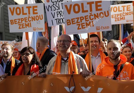 """Czech Republic's Prime Minister and former chairman of Social Democrats Bohuslav Sobotka with his party supporters march through Prague, Czech Republic, . Czech Republic is holding general elections from Oct. 20 to 21, 2017. The banners read: """"Vote for saver country"""
