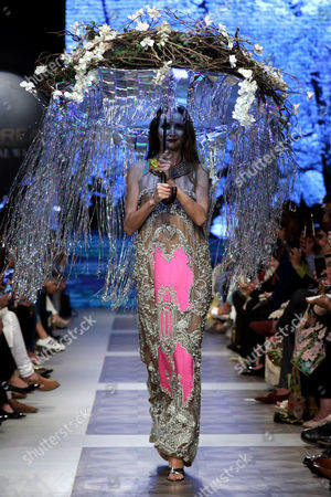 Stock Photo of A model presents a creation by Pakistani designer Ali Xeeshan during the Pakistan Fashion Design Council (PFDC) PFDC L?Oréal Paris Bridal Week 2017 in Lahore, Pakistan, 14 October 2017. (issued 15 October). The event runs through 14 to 16 October.