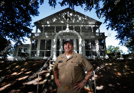 """Stock Image of Capt. David Hunt poses in front of the Quarters """"A"""", the shipyard commander's residence, at the Portsmouth Naval Shipyard in Kittery, Maine. Most Navy commanders don't have to run everything by a historic preservation committee but that's just one of the challenges Capt. Hunt faces he continues the work of updating the nation's oldest continuously operated public shipyard"""