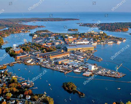 This October 2015 handout photo provided by the Portsmouth Naval Shipyard, shows the shipyard base in Kittery, Maine. Most Navy commanders don't have to run everything by a historic preservation committee but that's just one of the challenges Capt. David Hunt faces he continues the work of updating the nation's oldest continuously operated public shipyard