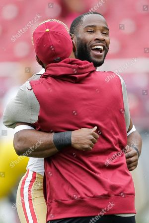 Pierre Garcon, DeAngelo Hall. San Francisco 49ers wide receiver Pierre Garcon (15) hugs Washington Redskins free safety DeAngelo Hall (23) before an NFL football game in Landover, Md