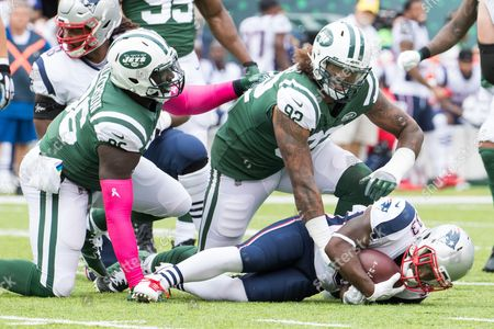 , 2017, New York Jets defensive end Leonard Williams (92) looks on after tackling New England Patriots running back Dion Lewis (33) during the NFL game between the New England Patriots and the New York Jets at MetLife Stadium in East Rutherford, New Jersey. The New England Patriots won 24-17