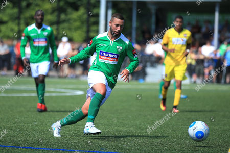 Leatherhead player manager Sammy Moore plays a ball forward during Leatherhead vs Bromley, Friendly Match Football at Fetcham Grove on 8th July 2017