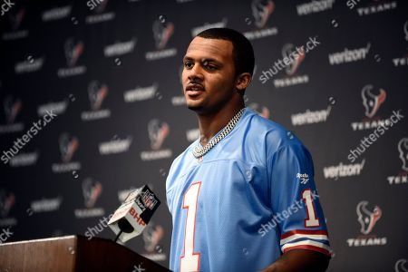 Houston Texans quarterback Deshaun Watson, wearing a Warren Moon Houston Oilers jersey, responds to a question during a news conference after after an NFL football game against the Cleveland Browns, in Houston