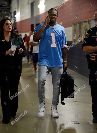 Houston Texans quarterback Deshaun Watson, wearing a Houston Oilers' Warren Moon jersey, departs from a news conference after an NFL football game against the Cleveland Browns, in Houston
