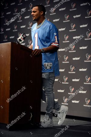 Houston Texans quarterback Deshaun Watson, wearing a Houston Oilers' Warren Moon jersey, responds to a question during a news conference after an NFL football game against the Cleveland Browns, in Houston