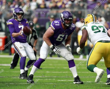 Stock Photo of Minnesota Vikings offensive guard Joe Berger (61) sets to block against the Green Bay Packers during an NFL football game, in Minneapolis