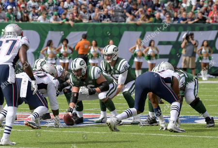 Josh McCown, Wesley Johnson. New York Jets quarterback Josh McCown (15) prepares to take the snap from New York Jets center Wesley Johnson (76) during the first half of an NFL football game against the New England Patriots, in East Rutherford, N.J