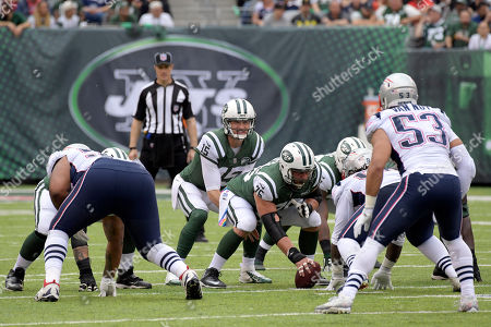 Josh McCown, Wesley Johnson. New York Jets quarterback Josh McCown (15) prepares to take the snap from center Wesley Johnson (76) during the first half of an NFL football game against the New England Patriots, in East Rutherford, N.J