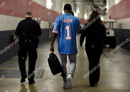 Houston Texans quarterback Deshaun Watson leaves a news conference wearing a Warren Moon jersey after an NFL football game against the Cleveland Browns, in Houston