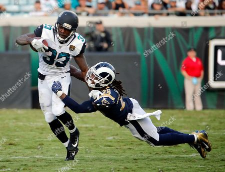 Chris Ivory, Mark Barron. Jacksonville Jaguars running back Chris Ivory (33) tries to get past Los Angeles Rams linebacker Mark Barron (26) during the first half of an NFL football game, in Jacksonville, Fla