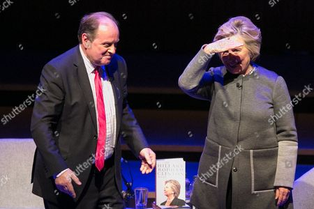 Stock Picture of James Naughtie and Hillary Clinton (l to r) Former US Secretary of State Hillary Clinton waves on stage following her talk at the London Literary Festival at The Royal Festival Hall, where she was speaking about her latest book 'What Happened' which reflects on her defeat by Donald Trump in the 2016 US presidential election.