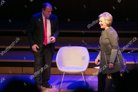 James Naughtie and Hillary Clinton (l to r) Former US Secretary of State Hillary Clinton waves on stage following her talk at the London Literary Festival at The Royal Festival Hall, where she was speaking about her latest book 'What Happened' which reflects on her defeat by Donald Trump in the 2016 US presidential election.