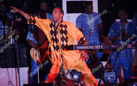 "Femi Kuti, son of late Afrobeat legend Fela Anikulapo Kuti, performs during ""Felabration,"" an annual event paying homage to his father, at the New Afrika Shrine in Lagos, Nigeria early . Thousands of Afrobeat enthusiasts danced through the night in a cavernous warehouse to commemorate the Nigerian-born musician who died in 1997"