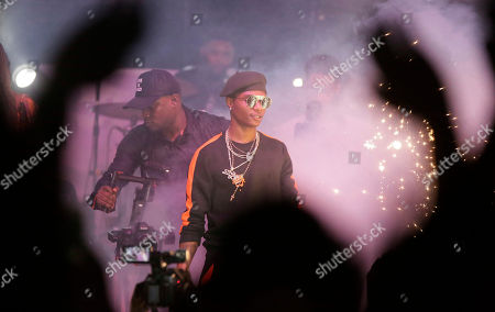 "Nigerian singer, Wizkid performs during ""Felabration,"" an annual event paying homage to late Afrobeat Legend Fela Kuti, at the New Afrika Shrine in Lagos, Nigeria early . Thousands of Afrobeat enthusiasts danced through the night in a cavernous warehouse to commemorate the Nigerian-born musician who died in 1997"