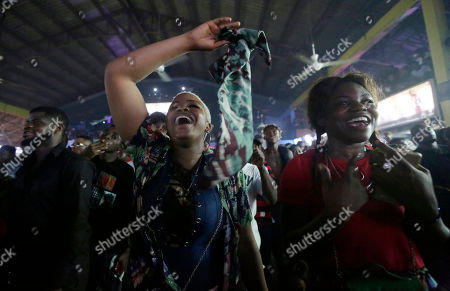 "Fans wave their hands as Femi Kuti, the son of the late Afrobeat legend Fela Anikulapo-Kuti, performs during ""Felabration,"" an annual event paying homage to his father, at the New Afrika Shrine in Lagos, Nigeria early . Thousands of Afrobeat enthusiasts danced through the night in a cavernous warehouse to commemorate the Nigerian-born musician who died in 1997"