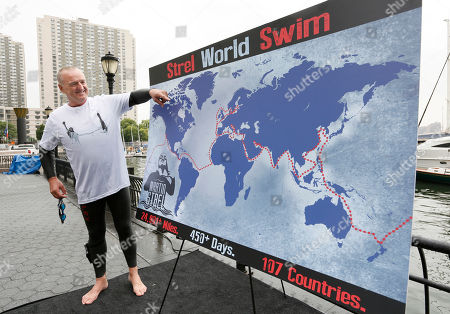 """Martin Strel illustrates the route for his planned """"Strel World Swim"""" at Brookfield Property Partners' site at North Cove Marina in Downtown Manhattan, in New York. On March 22, 2016, World Water Day, Strel will commence his """"Strel World Swim"""" through 107 countries in approximately 450 days as a means of spreading clean water awareness"""