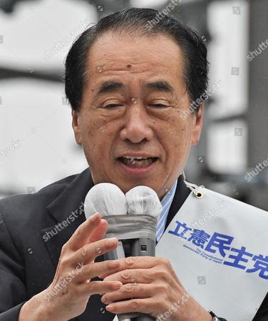 Former Prime Minister Naoto Kan speaks during the stump speech near the Kichijojii station
