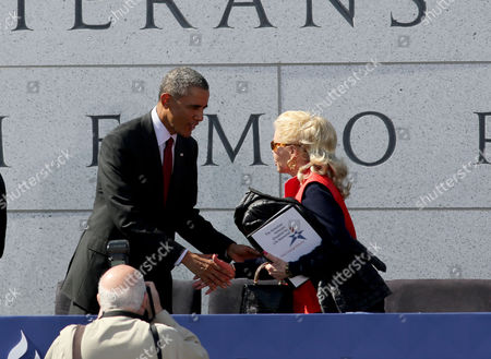 President Barack Obama, left, greets Lois Pope, Chairman DVLMF during the dedication ceremony of the American Veterans Disabled for Life Memorial, in Washington