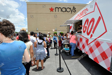 Chef Johnny Iuzzini hands out ice cream scoops at the Macy's Memorial City location in Houston, on . Iuzzinni hits the road with the Macy's Food Truck as part of the American Icons campaign