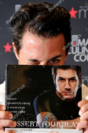 Chef Johnny Iuzzini poses for a photo at the Macy's Memorial City location in Houston, on . Iuzzinni hits the road with the Macy's Food Truck as part of the American Icons campaign