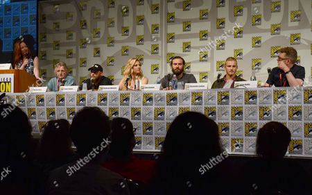 """Stock Image of Kate Hahn, and from left, screenwriter Michael Hirst, Travis Fimmel, Katheryn Winnick, Clive Standen, Alexander Ludwig and producer Julian Hobbs attend the """"Vikings"""" panel on Day 2 of Comic-Con International, in San Diego"""