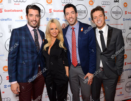 Jonathan Silver Scott, and from left, Pamela Anderson, Drew Scott, and J.D. Scott arrive at the Producers Ball at the Royal Ontario Museum, in Toronto
