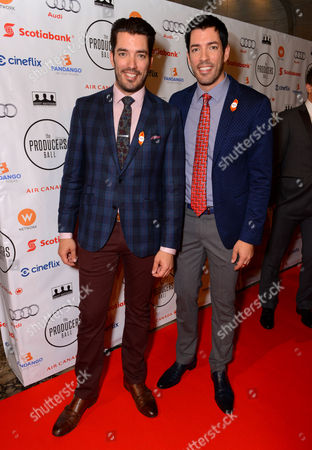 Jonathan Silver Scott, left, and Drew Scott arrive at the Producers Ball at the Royal Ontario Museum, in Toronto