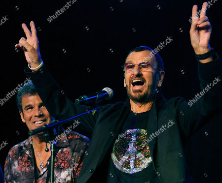 Ringo Starr flashes the peace sign alongside All Starr Band member Mark Rivera during a news conference at SIR studios in Los Angeles. Starr announced another leg of 2013 tour dates in Latin America and the U.S