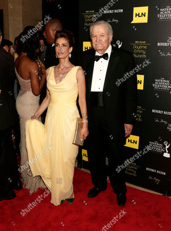Actors Kristian Alfonso, left, and John Aniston arrive at the 39th Annual Daytime Emmys Awards on HLN at the Beverly Hilton Hotel on in Beverly Hills, Calif