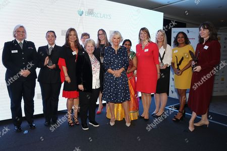 Debbie Ford (L), Lauren Moore (2ndL), Andrea Bonafe (3rdL), Cath Daley (4thL), Sandi Toksvig (5thL), Lea Vaughan (6thL), Camilla Duchess of Cornwall (C), Jane Luca (4thR), Laura Prescott (3rdR), Naomi Davis (R) and guests