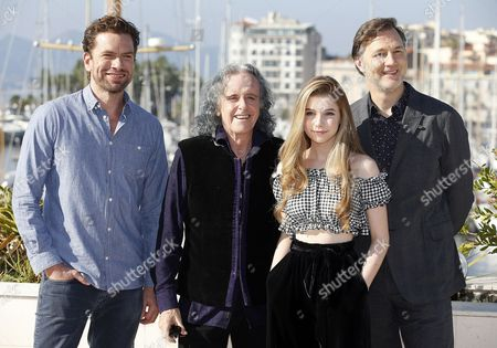 Stock Photo of Danish actor Nikolaj Lie Kaas (L), British musician Donovan (2-L), British actress Eleanor Worthington Cox (2-R) and British actor David Morrissey (R) pose during a photocall for the TV series 'Britannia' at the annual MIPCOM television content market in Cannes, France, 16 October 2017. The media event runs from 16 to 19 October.