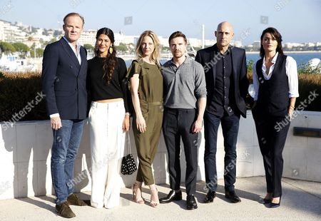 British actor Alistair Petrie (L), British-Moroccan actress Karima McAdams (2-L), British actress Anastasia Griffith (3-L), British actor Joe Dempsie(3-R), British actor Mark Strong (2-R), and Belgian actress Lynn Renee (R) pose during a photocall for the TV series 'Deep State' at the annual MIPCOM television content market in Cannes, France, 16 October 2017. The media event runs from 16 to 19 October.