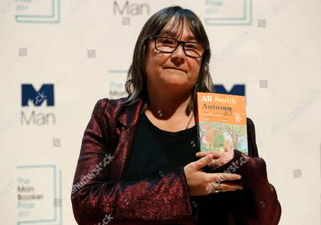 Author Ali Smith of Britain with her book 'Autumn' during a photocall with all six shortlisted authors of the 2017 Man Booker Prize for Fiction, in London, . The winner of the award will be announced Tuesday at a ceremony in London