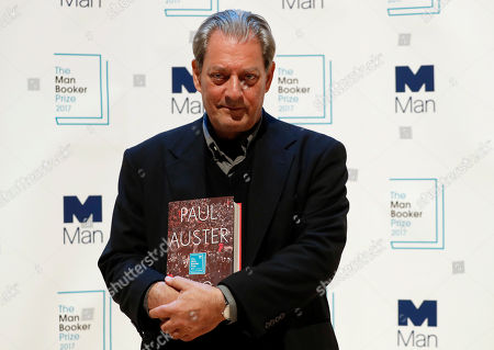 Author Paul Auster of the United States with his book '4321' during a photocall with all six shortlisted authors of the 2017 Man Booker Prize for Fiction, in London, . The winner of the award will be announced Tuesday at a ceremony in London
