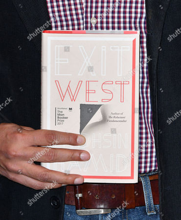 Stock Image of Mohsin Hamid with his book 'Exit West'