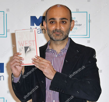 Stock Photo of Mohsin Hamid with his book 'Exit West'