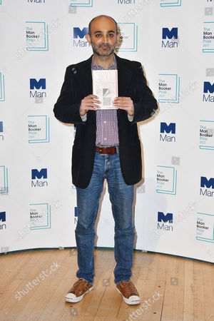 Mohsin Hamid with his book 'Exit West'