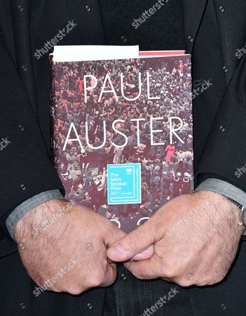 Paul Auster with his book '4321'