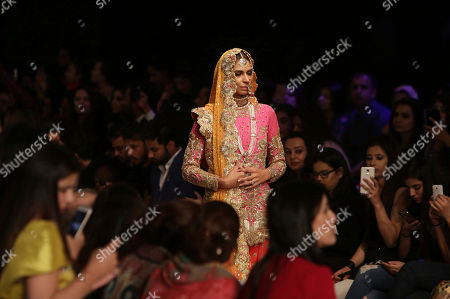 A model presents a creation of designer Nomi Ansari during the Bridal Fashion Week organized by the Pakistan Fashion Design Council, in Lahore, Pakistan