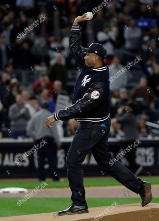 Bernie Williams throws out the ceremonial first pitch before Game 3 of baseball's American League Championship Series between the Houston Astros and the New York Yankees, in New York