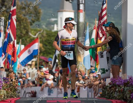 Stock Picture of Denis Chevrot of France,  is congratulated by 3 time women's champion, Chrissie Wellington, as he finishes the Ironman World Championship in Kailua-Kona, Hawaii, USA, 14 October 2017.