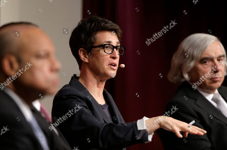 """Stock Image of Rachel Maddow, Ernest Moniz. MSNBC television anchor Rachel Maddow, host of the Rachel Maddow Show, center, moderates a panel, at a forum called """"Perspectives on National Security,"""" at the John F. Kennedy School of Government, as Ernest Moniz, former U.S. Secretary of Energy, right, looks on on the campus of Harvard University, in Cambridge, Mass"""